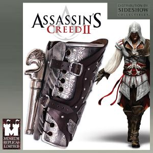 ASSASSIN'S CREED II - GARDE BRAS & PISTOLET EZIO OFFICIELS
